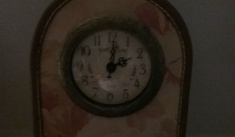 a mantle clock showing 2am