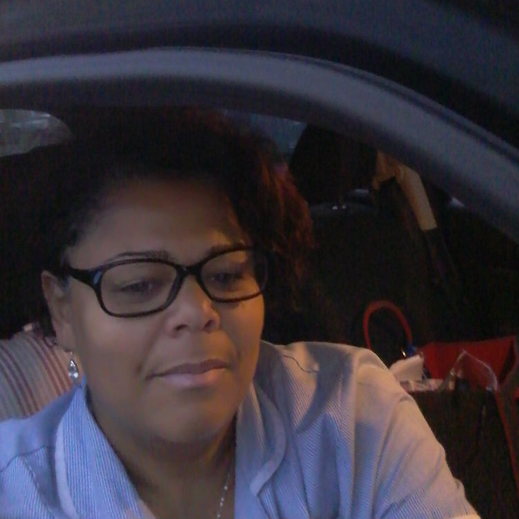 Annie in the car, about to leave her house