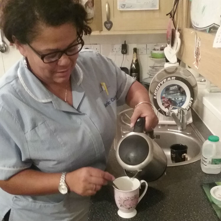 Nurse Annie making a hot drink for a family