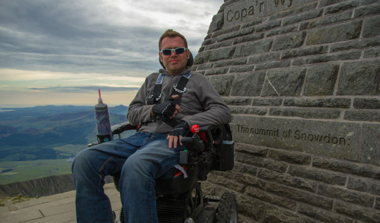 Man with MND scales Snowdon