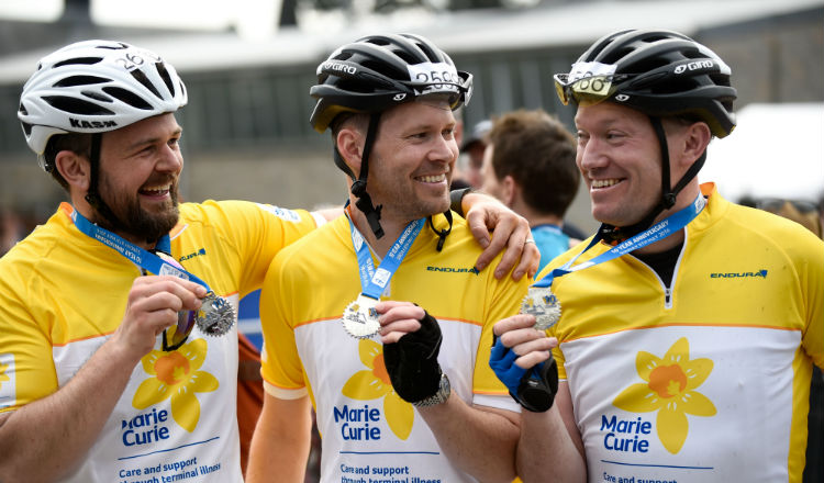 Happy group of Marie Curie cyclists