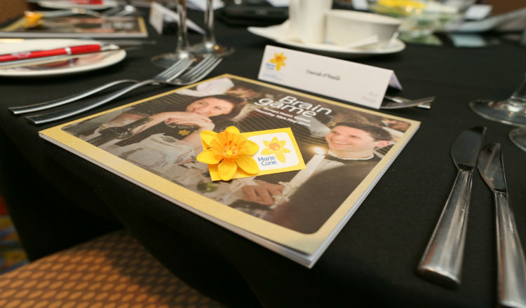 A copy of the Belfast Brain Game programme sits on a table