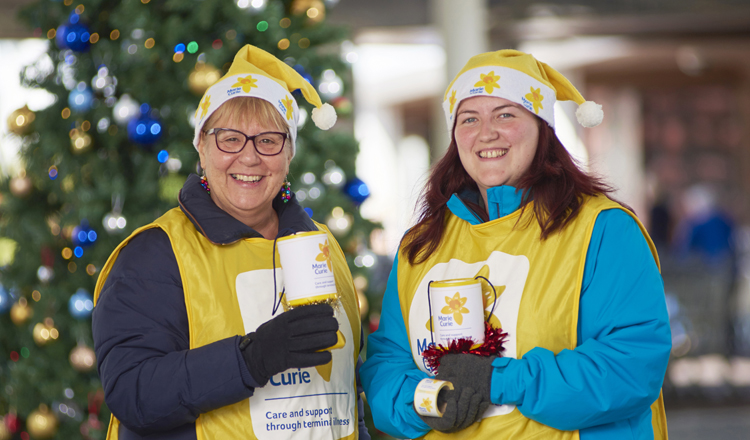 Volunteer in a Marie Curie charity shop