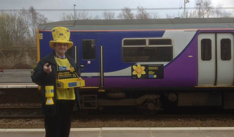 Marie Curie collector with a Northern Rail train