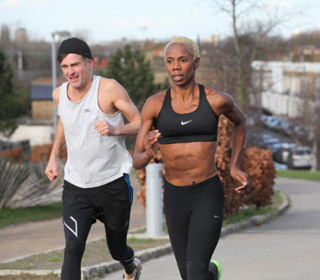 Trainer Ade Aboaba running with male client