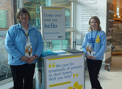 two marie curie fundraising volunteers
