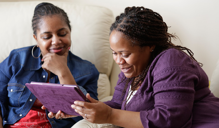 Two women looking at an iPad