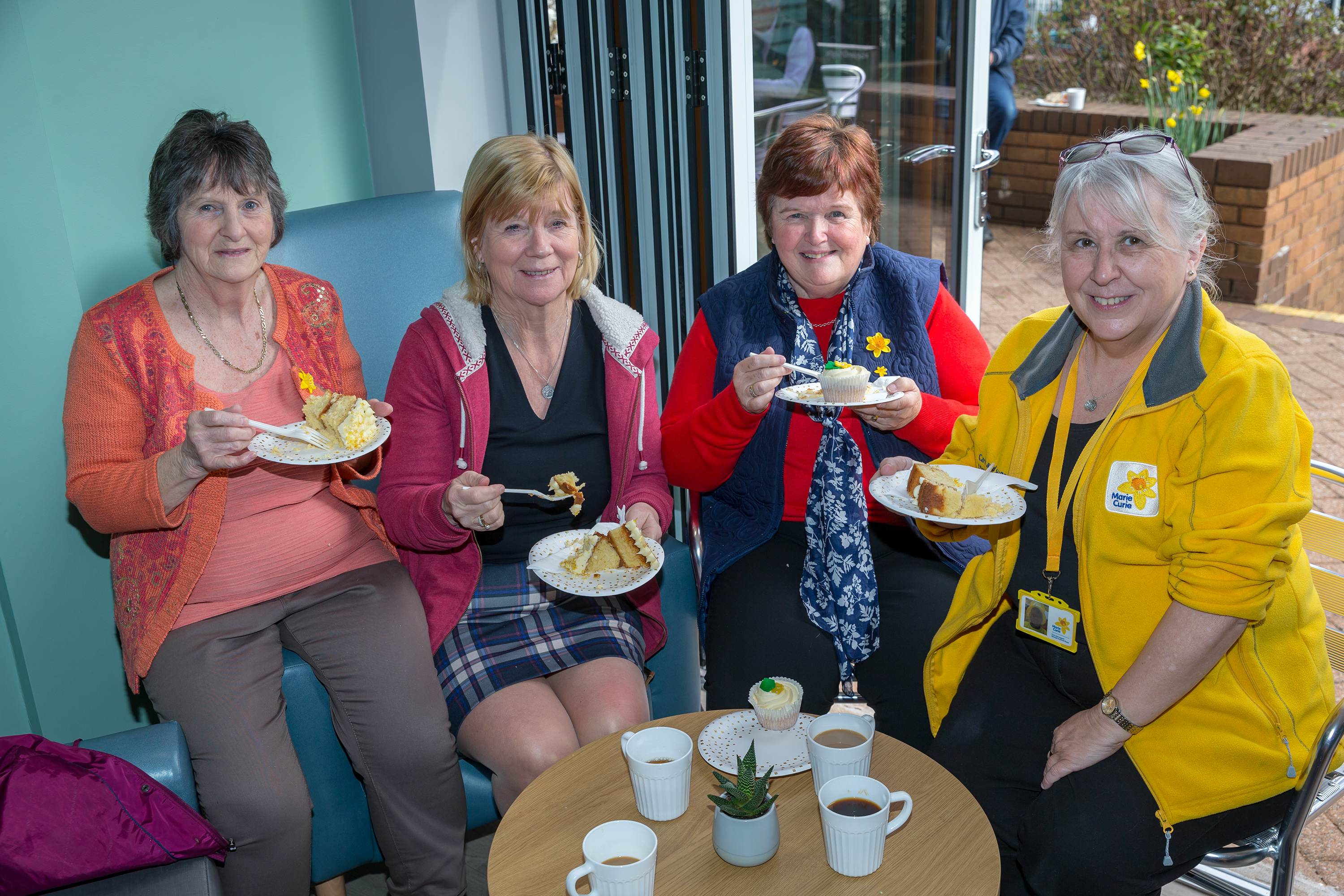 Members of the Caerphilly fundraising group enjoying some tea and cake at the new Marie Curie Cafe